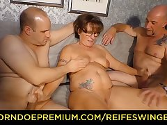 REIFE SWINGER - Chubby German granny sucks coupled with fucks two cocks in naughty threesome