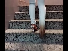 Candid generalized in high heels climbing stairs