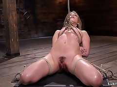 Gagged blonde in bondage feet agonizing