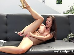 Pretty MILF in high heels moans while toying pussy
