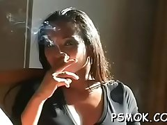 Older whore holding a cigarette and playing with herself